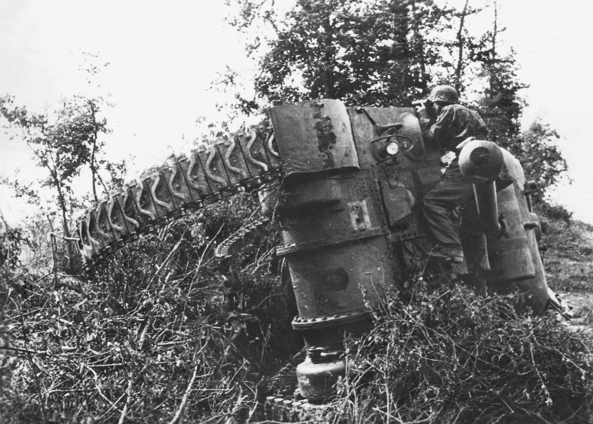 German soldier by a destroyed Sherman, 1944