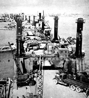 A Busy Wharf at 'Mulberry' Harbour; Second World War, 1944.